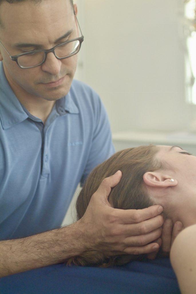 Daniel Akins massage therapist works on client's neck